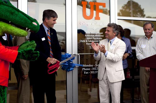 Michael Good, M.D., dean of the UF College of Medicine, and Mark Gold, M.D., chairman of the department of psychiatry, officially cut the ribbon to open the new Springhill Health Clinic with on Wednesday, July 1. The new facility on Northwest 39th Avenue, near Santa Fe Community College and across from Shands Vista, complements psychiatry department activities at the McKnight Brain Institute and Health Science Center, providing an additional location for programs, training and research.